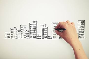 hand drawing cityscape on white paper