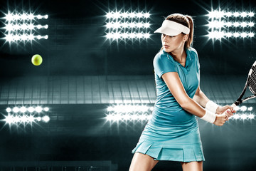 Beautiful sport woman tennis player with racket in blue costume