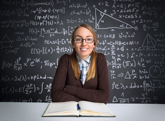 Smiling female student siting front open book