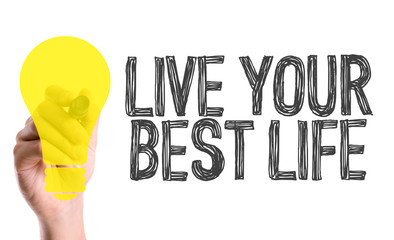 Hand with marker writing the word Live Your Best Life