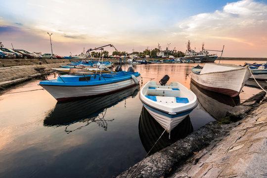 fishing boats in port of Sozopol at sunrise