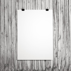 blank sheet on a wooden boards background