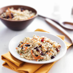 cold couscous salad with seeds and nuts on table top