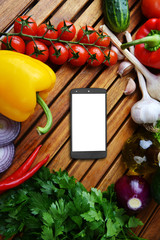 phone and fresh vegetables