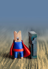 Leader concept. Clothespin superhero nimber one. letter 1. copy space