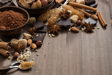 Foto op Plexiglas Chocolade chocolate, cocoa, nuts and spices on wooden background