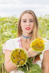 Girl on a sunflower field