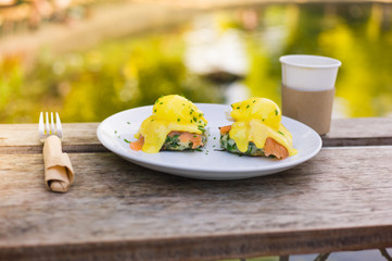 Eggs benedict on a plate in the park