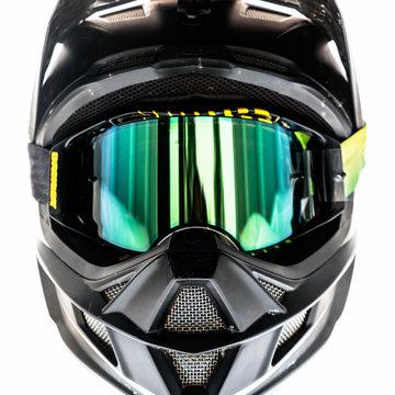 black full-face helmet with green reflective lens