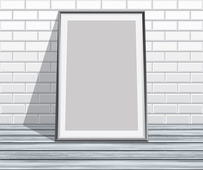 Empty vector frame on floor and brick wall