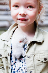 Portrait of a girl with a little baby chinchilla