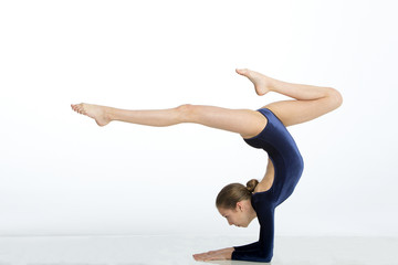 Female gymnast doing a handstand pose