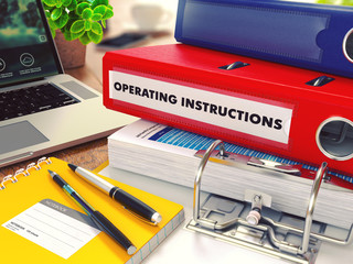 Operating Instructions on Red Office Folder. Toned Image.