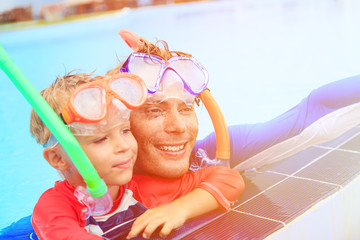 father and son snorkeling making selife at beach