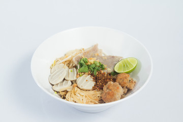 noodles with vegetables and meat on white background