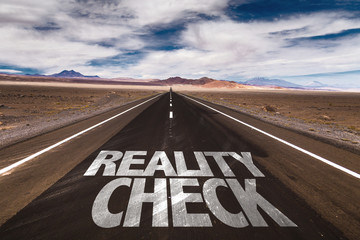 Reality Check written on desert road