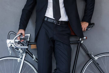 Businessman with bicycle.