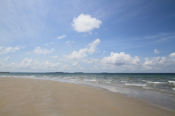 Beach and tropical sea with blue sky and cloud