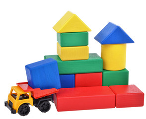plastic toy truck with wooden cubes tower. Building process