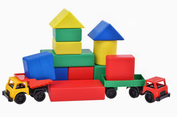 plastic toy trucks with wooden cubes tower. Building process