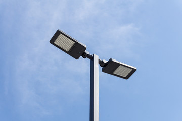 Modern street lighting against blue sky - bottom view - horizontal image