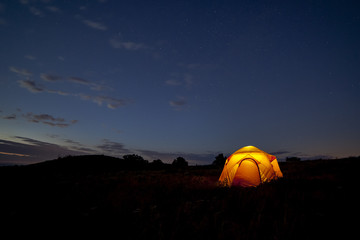 Starry Night/ A yellow tent glows against a starry sky in Shenandoah National Park, Virginia.