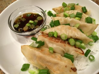 Appetizer Potstickers with Rice and Soy Sauce