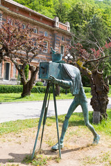Monument to the photographer in the summer park. The town is famous for its mineral water industry