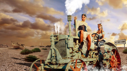 Two sexy woman in the steam-punk clothes are driving vintage tra