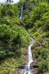 Waterfall in the summer mountains