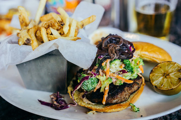 Burger with coleslaw and french fries