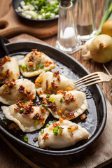 Dumplings with meat, onion and bacon.