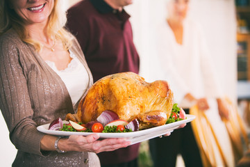 Thanksgiving: Woman Holding Platter With Roast Turkey And Garnis