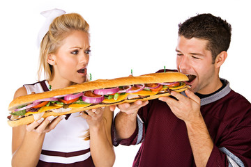 Football: Cheerleader Annoyed That Man Is Eating