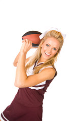 Football: Cheerleader Throwing Ball
