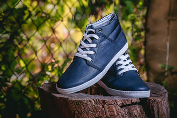 Men's shoes, sneakers on nature