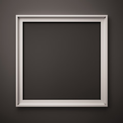 white picture frame on the black wall