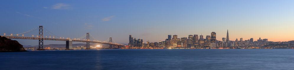 San Francisco – Oakland Bay Bridge with lights at sunset time