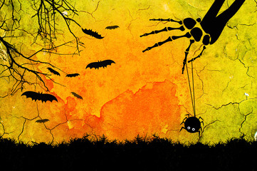 Bone hand picking up a photo paper ,space for note on Halloween background