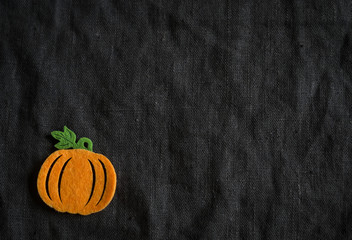 brown fabric texture and homemade Halloween decoration - pumpkin
