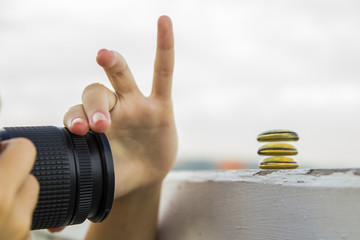 Woman's hand with lens focusing on zen glass stones. Concept: Stock Photography,Zen, Photographer.