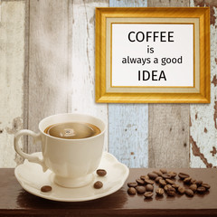"Classic frame with quote ""Coffee is always a good idea"" and coff"