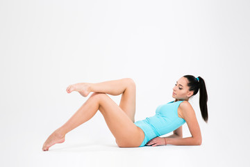 Attractive acrobat woman stretching legs