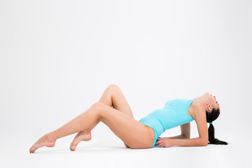 Portrait of a acrobat pertty girl workout on the floor