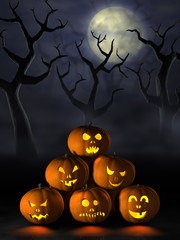 Stack of Halloween pumpkins in a spooky forest at night