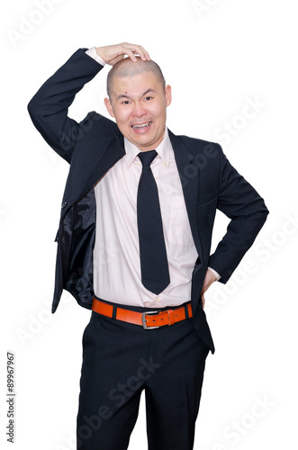Angry Asian businessman in suit over white