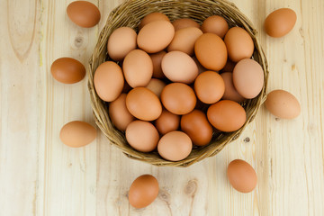 Full of Eggs put in a wicker basket in wooden background
