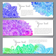 Three vector banners with doodle flowers, watercolor texture