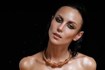 fashion portrait of shining glamourous woman on black background