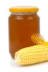 fresh corn with honey isolated on white